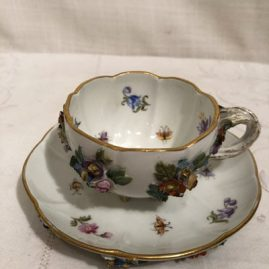 Rare Meissen cup and saucer with raised flower decoration and 6 raised feet on the bottom of the cup and 6 raised feet on the bottom of the saucer. Circa-1880s. 2 1/2 inches tall saucer is 4 7/8 inches in diameter. Price on request.
