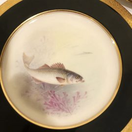 Close up of one of the eleven Lenox artist signed W. H. Morley fish plates