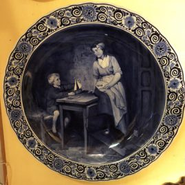 Large round Royal Delft plaque after Bloomers