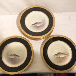 Set of eleven fish plates artist signed w.h. Morley, each painted with different fish.