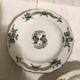 One of fourteen Meissen green court dragon dessert plates