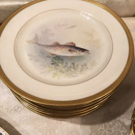 Close up of onr of twelve Lenox fish plates artist signed W.H. Morley