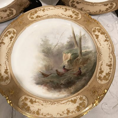 Close up of one of the set of eleven Doulton Burslem bird plates each painted differently