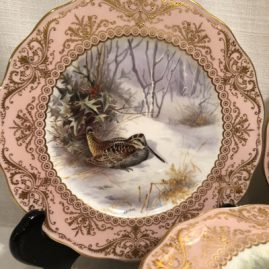 Close up of one of the set of twelve elaborately painted bird plates