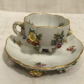Picture of one of the six Meissen demitasse cups and saucers with raised flowers