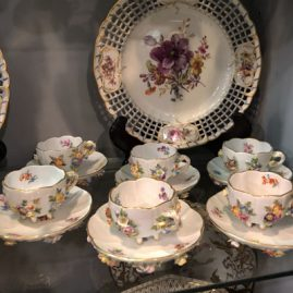 Set of six Meissen cups and saucers with raised flowers