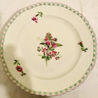 Set of fourteen KPM dinner plates with raised forget me nots around the borders