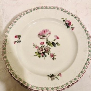 Set of fourteen KPM dinner plates with raised forget me nots around borders