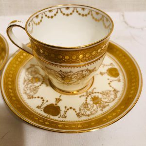 Pair of Minton Gilded and Jeweled Demitasse Cups and Saucers