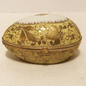 Le Tallec Egg Shape Porcelain Box With Profuse Gilding and Gold Jeweling